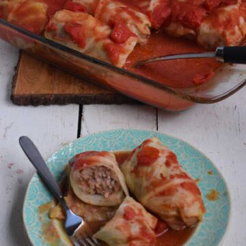 Cabbage stuffed with ground meat, rice, and vegetables, baked in sauce