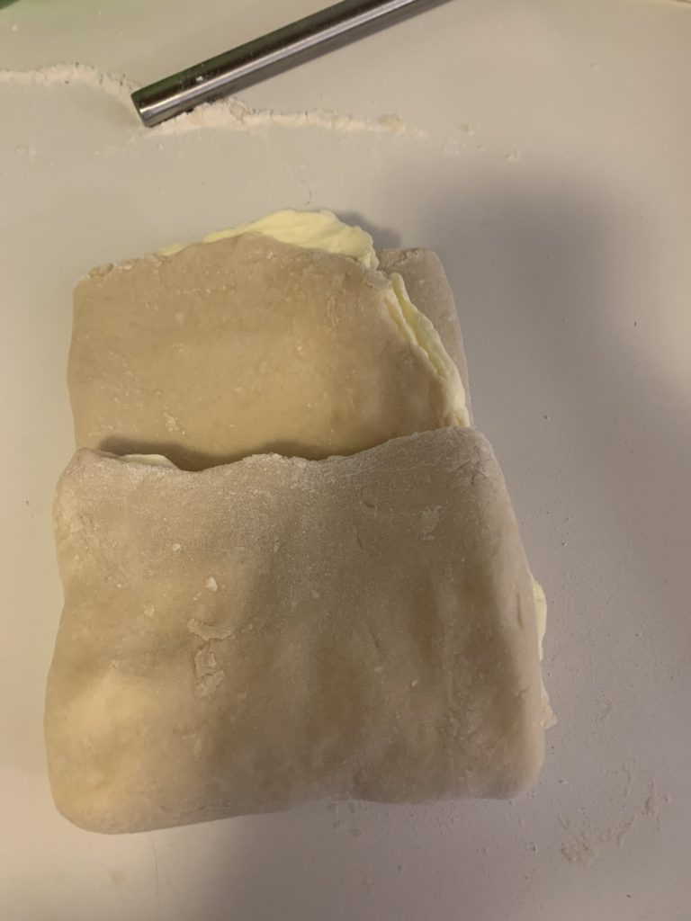 Dough with butter cut in half