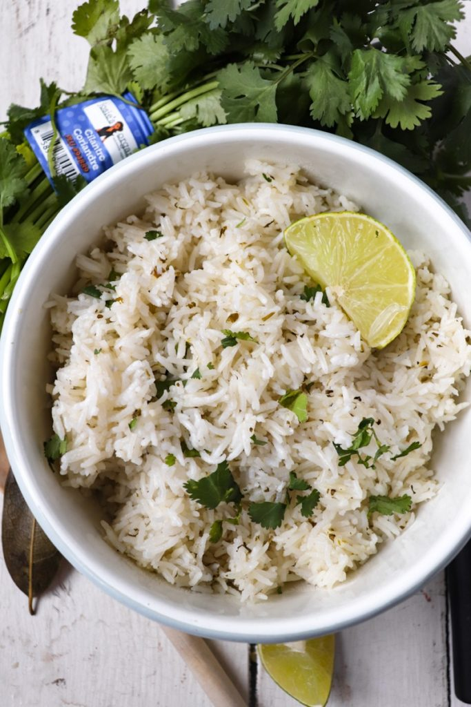 rice with cilantro and lime wedge