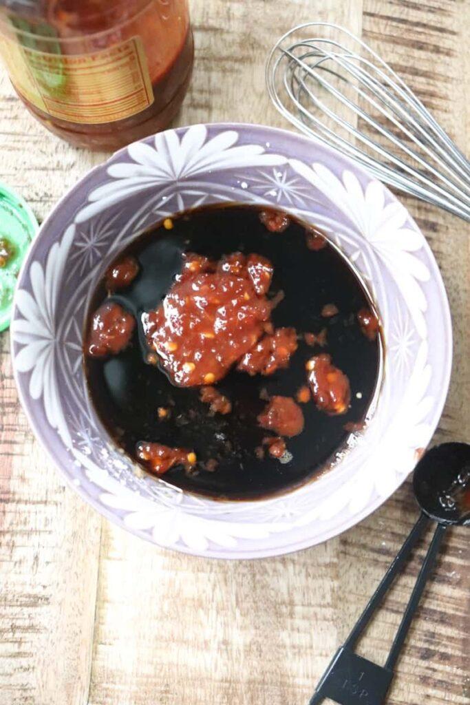 sambal oelek and sauce sauce in a purple bowl