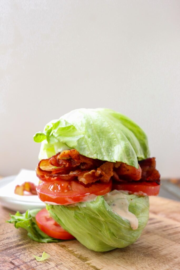 iceberg lettuce halves with ranch, tomato, and bacon inside