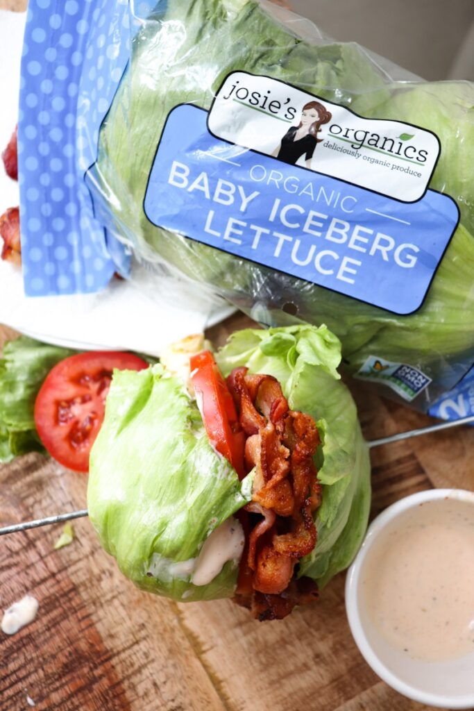 sideways shot of blt with baby iceberg lettuce packaging in shot