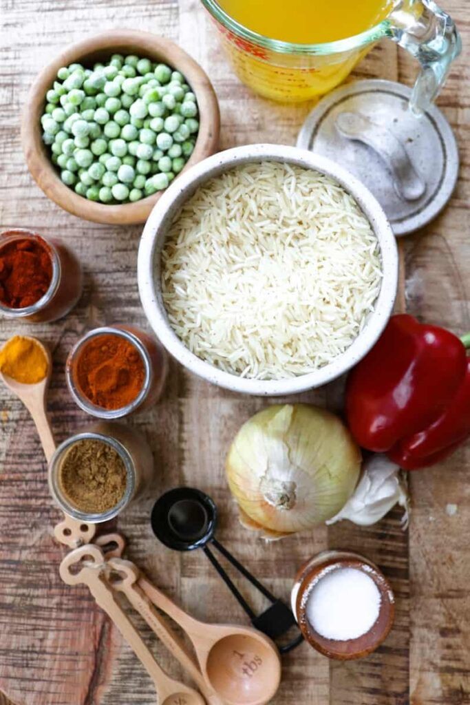 spicy rice ingredients laid out on a wooden background