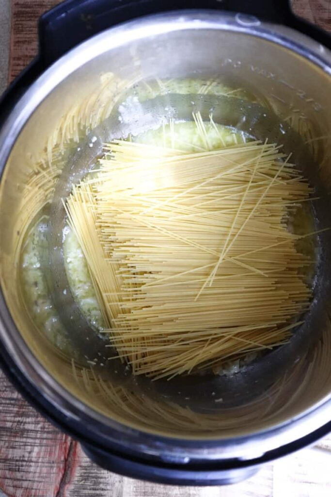 angel hair pasta criss crossed throughout pot