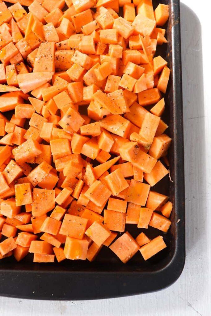 diced sweet potatoes on a roasting pan