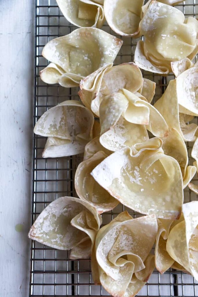 par cooked wonton cups on a metal cooling rack